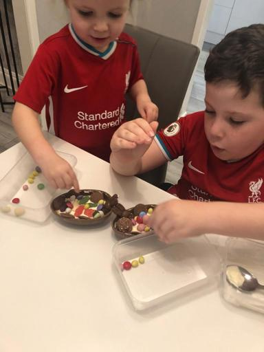 Two young LDSA members decorate their Easter eggs.