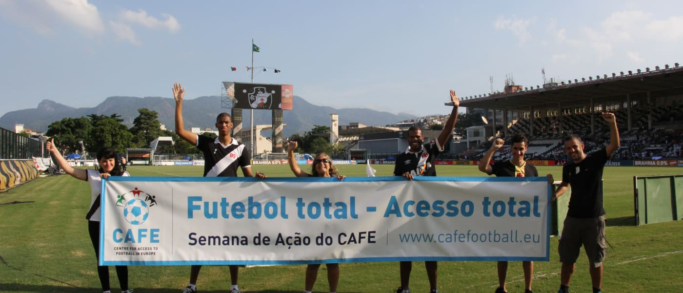Players in Brazil with a CAFE Week of Action banner