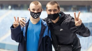 Disabled fan and player wearing face coverings