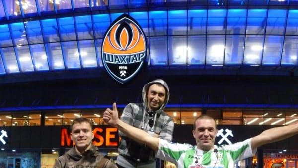 Yury Kovalevsky and fellow fans outside a stadium