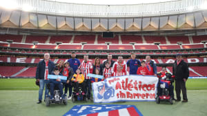 Disabled Atletico Madrid fans with players