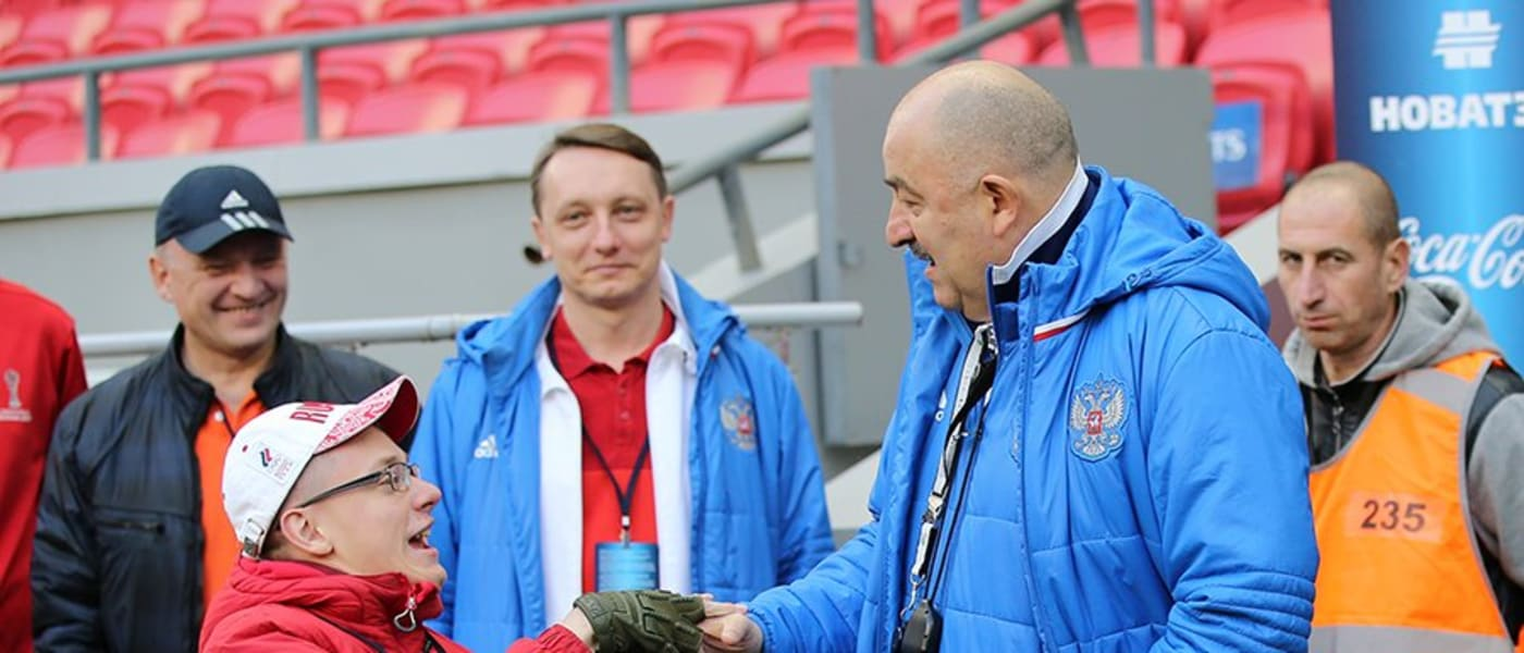 Dmitry Korchagin shaking hands with officials