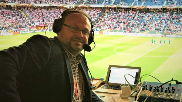 An audio-descriptive commentator commentating at the stadium
