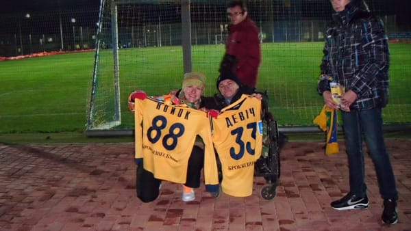 Olexiy Moskalenko and fellow fans with Metalist Kharkiv shirts