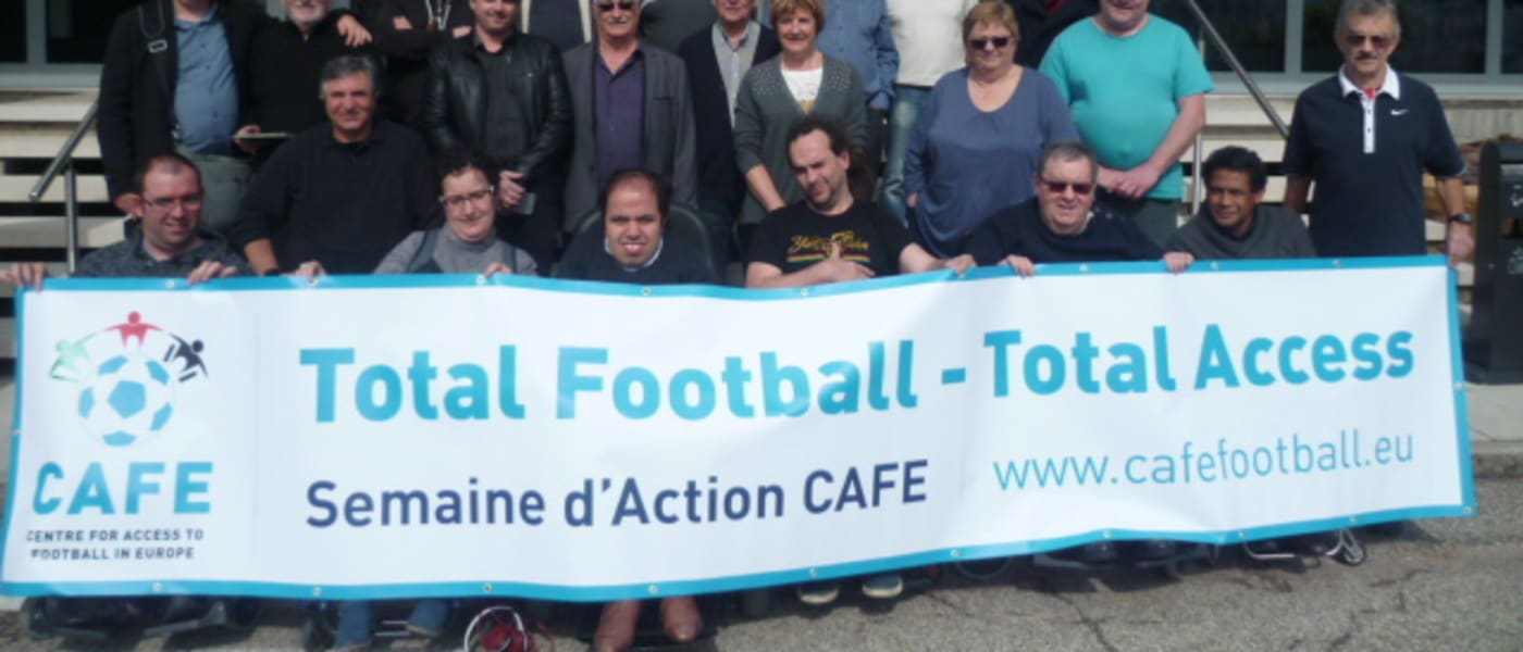Members of the French NDSA holding a CAFE Week of Action banner