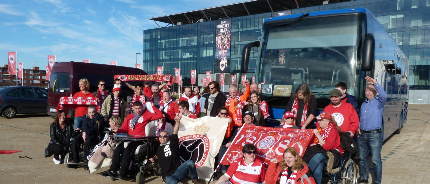 a disabled supporters association gathered beside their bus