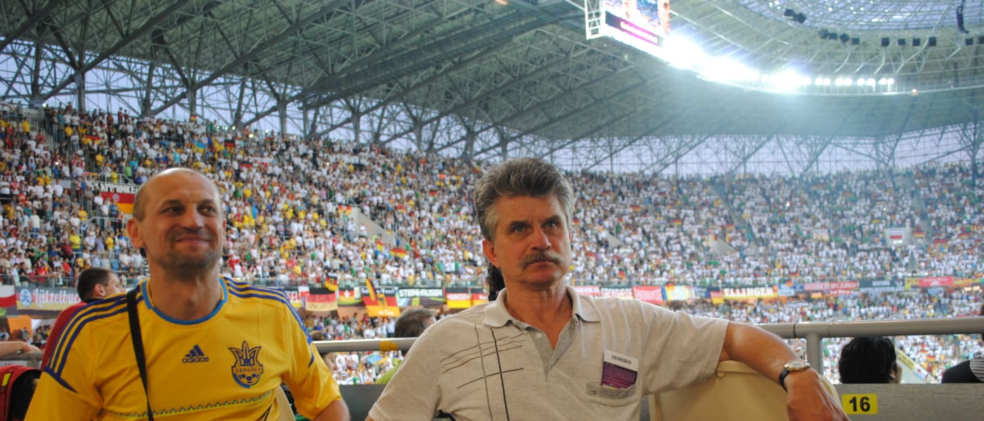 Yaroslav Hrybalskyy with a fellow supporter at a stadium