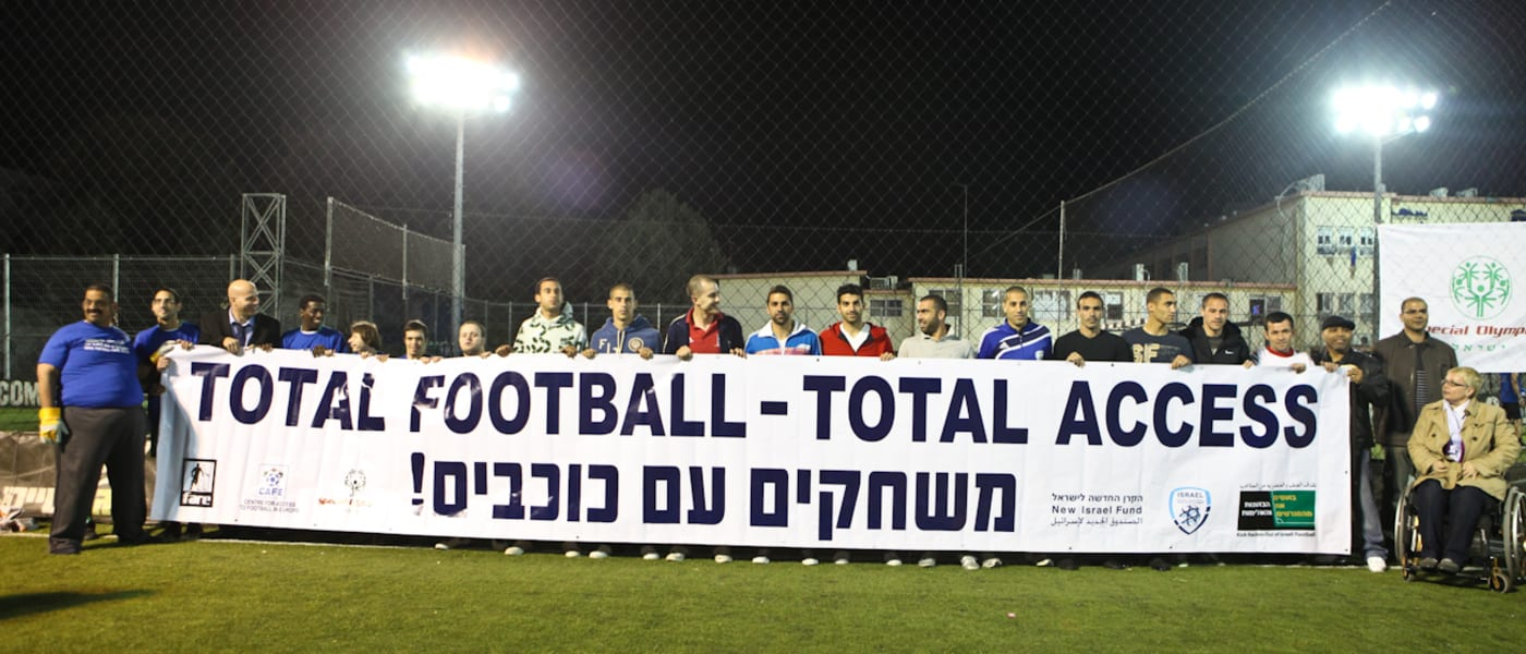 Joyce Cook and Israeli fans with a Total Football Total Access banner