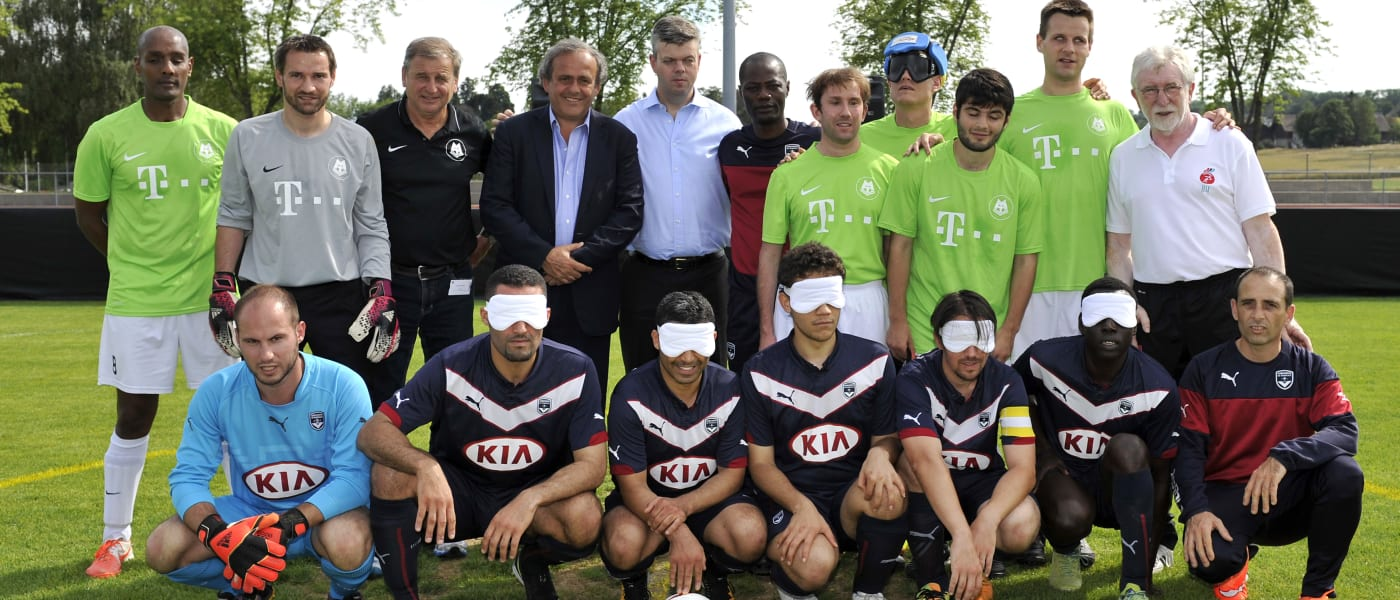 Participants in a blind football match