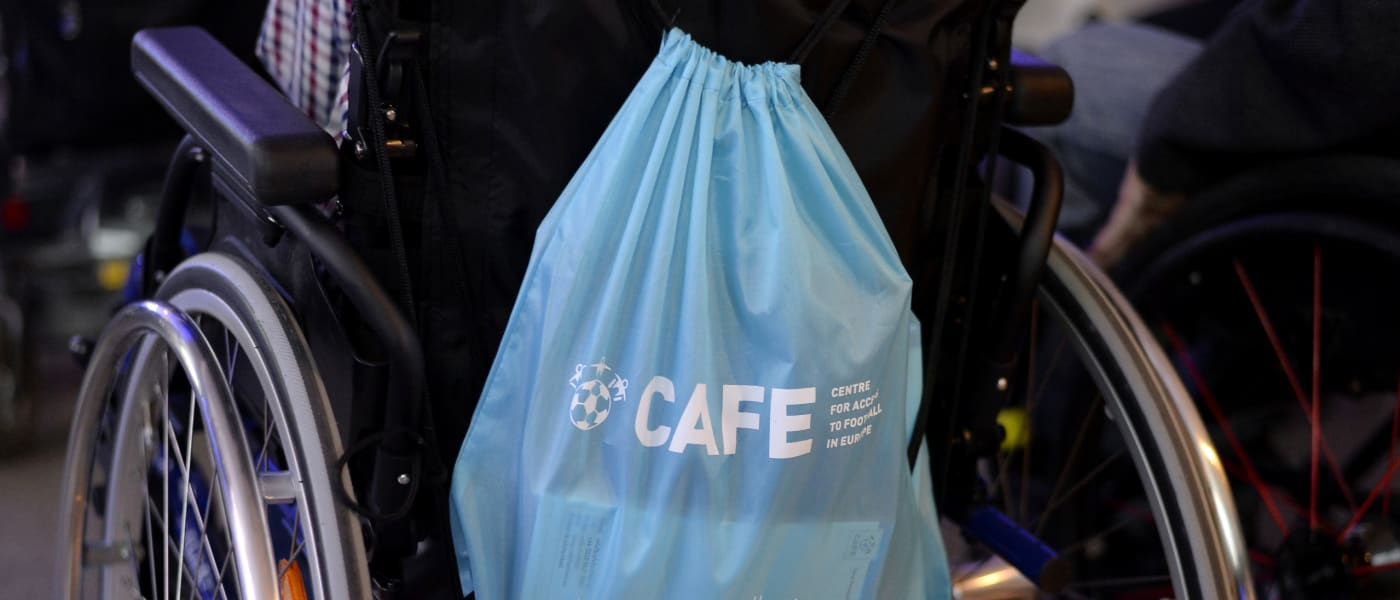 A CAFE rucksack on the back of a wheelchair