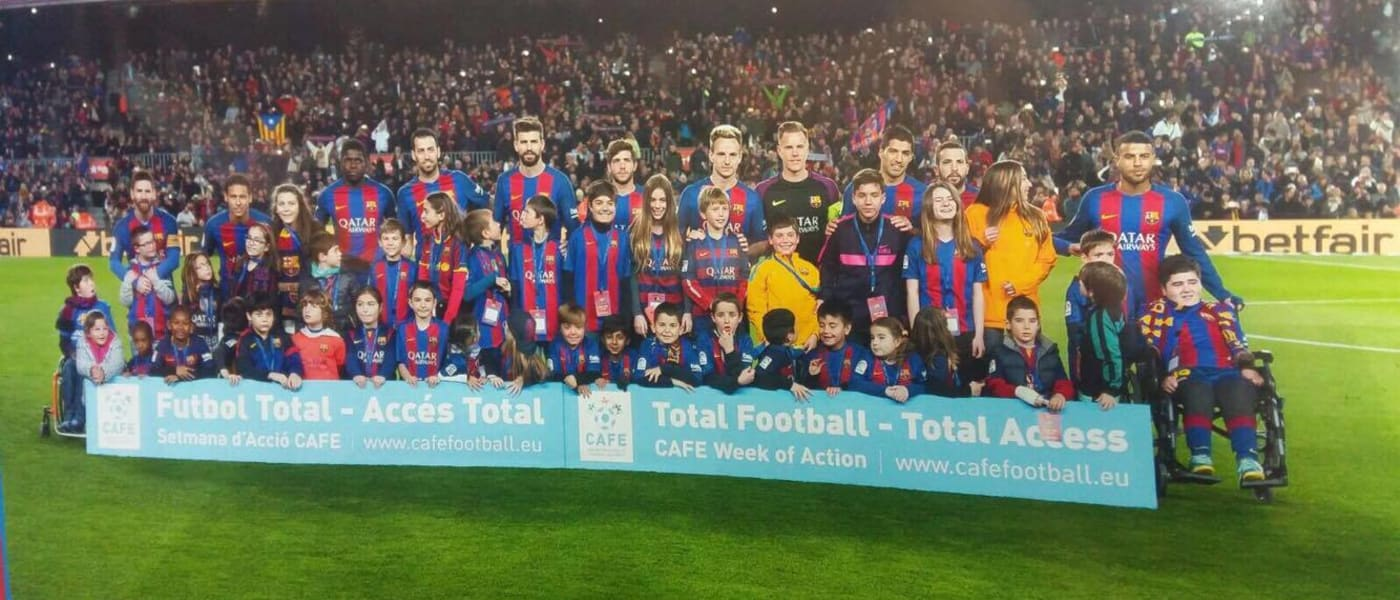 Barcelona team with player escorts and CAFE banner