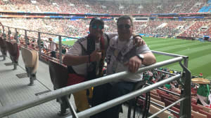 Disabled Germany fan and companion at stadium in Russia