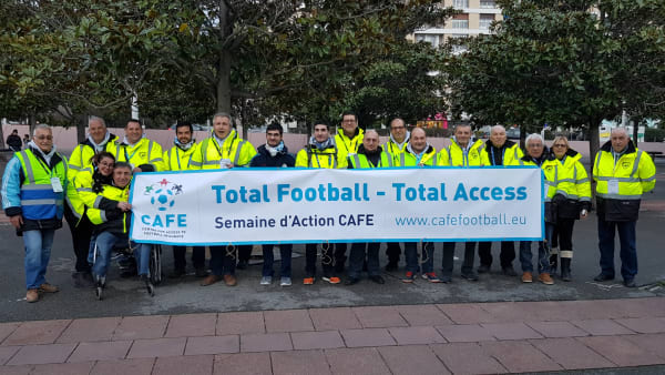 Stewards gathered with a CAFE Week of Action banner