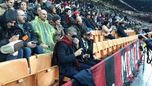 Partially sighted and blind fans listening to ADC at San Siro