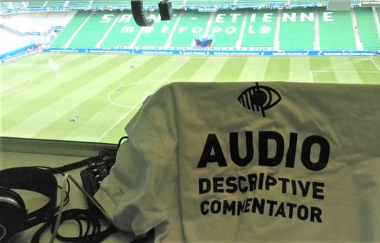 Audio descriptive commentary written on the back of a football shirt