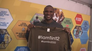 Eric Abidal with colour blind awareness t-shirt