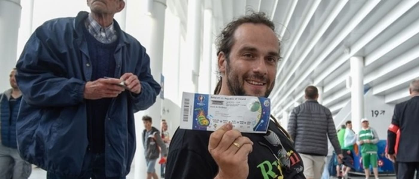 Jean-Pierre Inacio holding his ticket