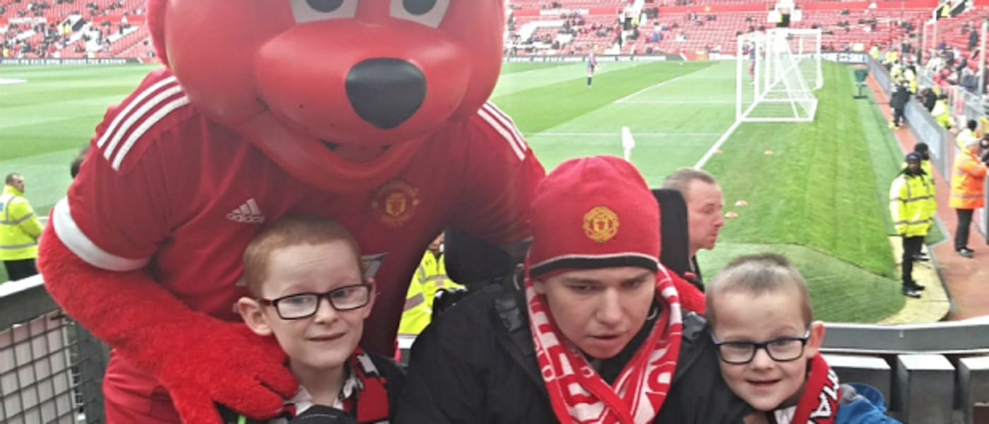 Martin Emerys three children with a Manchester United mascot