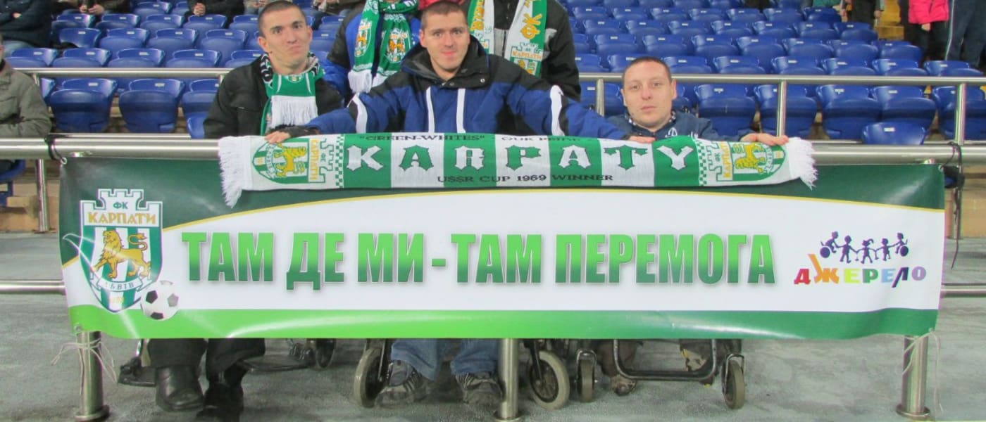 Taras Kontsevich and fellow fans with a banner
