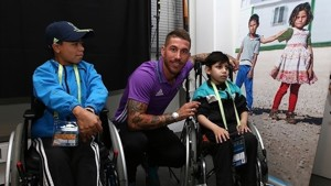Disabled youngsters accompany UEFA Super Cup captains onto the pitch